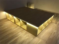 """This waterbed frame hack is very similar to the """"A full-sized bed built from KALLAX shelves"""", but was build to support a full-sized waterbed. Diy Bedframe With Storage, Diy Storage Ottoman, Bed Frame With Storage, Diy Bed Frame, Bed Designs With Storage, Homemade Storage, Homemade Beds, Waterbed Frame, Platform Bed Designs"""