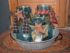 Jars & a pie pan.  Would be great for small bathroom items: cotton balls, swabs, etc.