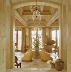 Arched door, beautiful ceiling, stony surfaces.. I appreciate a lot about this Tuscan home in California.