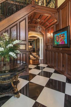 Foyer intrigues with porcelain flooring and custom woodwork
