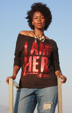 """I AM HER"" Est. 1913 DST Limited Edition Oversized Tee: Be Bold, Daring and Fearless! Est. 1913 DST Oversized Tee intended to celebrate the legacy of Delta Sigma Theta Sorority Incorporated while uplifting, inspiring, transforming and empowering women and girls. Est.1913 piece to be worn as an oversized tee with a comfy fit."