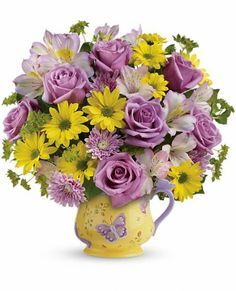 Teleflora's Butterfly Serenity Bouquet in a ceramic mug for Mother's Day