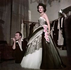 Actress Geraldine Brooks trying on a dress at the fashion house of Emilio Schuberth, Rome, August 1951