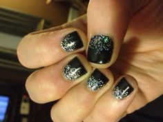 Black OPI GEL manicure w/ loose iridescent glitter applied and the OPI GEL top coat :) Done by Sheri at Sculptures in North Providence, Rhode Island