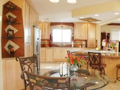 See how a kitchen can serve as a second living room with functional stations for working, dining, relaxing and entertaining.