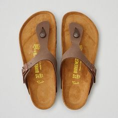 Birkenstock Gizeh Sandal ($95) ❤ liked on Polyvore featuring shoes, sandals, brown, brown buckle shoes, american eagle outfitters shoes, buckle sandals, buckle shoes and brown sandals