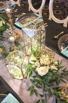 Geometric Figurines as armatures for the floral designs and geometric glass lanterns / http://www.deerpearlflowers.com/terrarium-geometric-details-ideas/