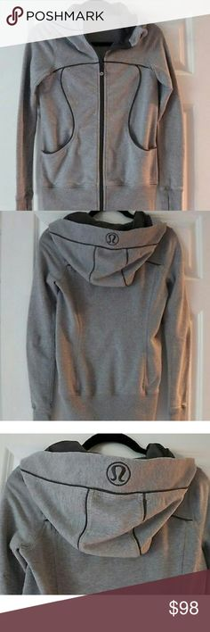 Lululemon Sweatshirt Hoodie This is a classic Lululemon hoodie in a beautiful gray- size 4. It has the cutest Omega logo on the front and on the hoodie. It is a bit fitted--and this is a size 4-- I bought it hoping I could rock it. It is in like-new condition- as I was barely wore it, but maybe 3 times. Lululemon Jackets & Coats