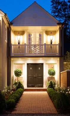 Such pretty curb appeal. I generally don't like balconies facing the front of a house. but the front door, lighting, topiaries and brick walk are so fabulous here Style At Home, Beautiful Architecture, Architecture Design, Garden Architecture, Design Exterior, Modern Exterior, Simple House Exterior, Black Exterior, Home Goods Decor