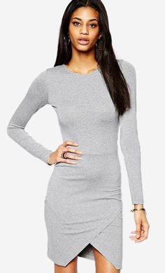 5a65767eae Made from a soft touch stretch fabric. Crew neckline. Asymmetric hem. Body-