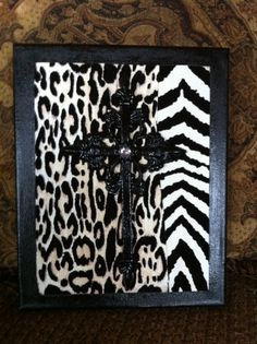 Cross on a canvas covered with cheetah and zebra designer paper