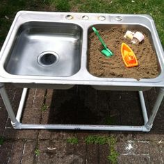 Recycled sink used as a sand and water table!
