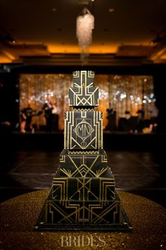 The six-tiered, black and gold Art Deco-designed dessert went perfectly with the Nicole and Michael Phelps' bash New Years Wedding, New Years Eve Weddings, Great Gatsby Wedding, Gatsby Theme, Glamorous Wedding, 1920s Wedding, Great Gatsby Cake, Speakeasy Wedding, Gatsby Party