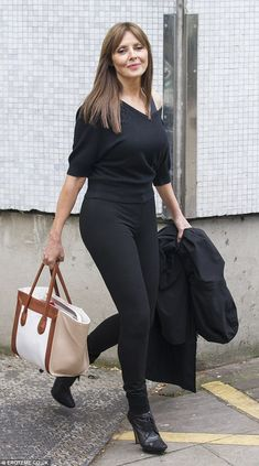 Sexy as f###.         Carol Vorderman looks slim in Fame inspired off-the-shoulder top and spray on jeans | Mail Online