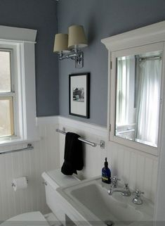 White bathroom with color accent & beadboard