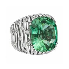 """Paolo Costagli new Flutti collection, 2017 ~ Mint tourmaline """"Flutti"""" tapered cocktail ring, showcasing a cushion-cut mint tourmaline weighing 15.17cts, in a 18k white gold openwork setting with round-cut diamond accents"""