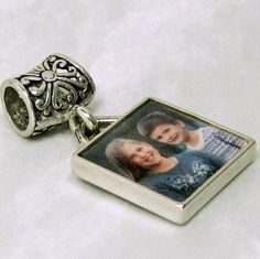 A picture frame photo charm for your name brands bracelet. Or wear it as a pendant.