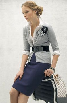 Gray cardigan, white shirt, black belt. Wouldn't wear the skirt, most likely navy pants would work though.