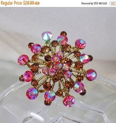 This  #vintage AB pink and brown rhinestone snowflake brooch pendant is sparkly and fun!  It features a silver tone setting with textured back, filled with AB pink rhineston... #ecochic #etsy #jewelry #jewellery