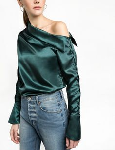 Green charmeuse satin one shoulder shirt with buttons along sleeves. 100% satin polyester Made by usModel's height is 5'.8