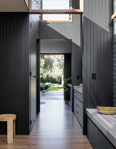 Love the charcoal brick, the frames of the windows above the doors. A series of full height concealed sliding doors act as walls that can section off the bedroom from the hallway and living space as required. Living Tv, Living Spaces, Living Area, Interior Barn Doors, Interior And Exterior, Interior Paint, Casa Loft, Duplex, Wall Cladding