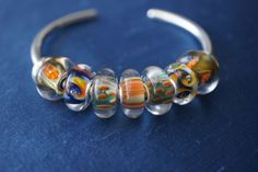 S&B oranges on a Trollbeads Bangle! Do you have yours yet?  This one is from a collector on Trollbeads Gallery Forum!  http://www.trollbeadsgallery.com/bangle/
