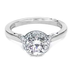 'Interest from every angle!' Tacori Dantela Platinum Engagement Ring style# 2639RD65 for about $3,630 ( 2639 RD 6.5 Platinum and goes with Tacori's Mens Wedding Ring 697W www.tqdiamonds.com/shop-online/tacori/tacori-697w-platinum-crescent-wedding-band.html)