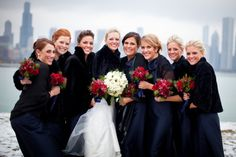 bridesmaids in navy with black fur shawls