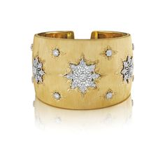 Buccellati - An Important Diamond and Gold Cuff Bracelet. Designed as a textured yellow gold hinged cuff, set with three circular-cut diamond navette-shaped panels, within engraved gold detail, mounted in 18K yellow gold.