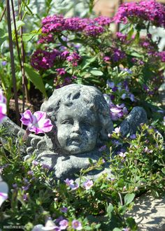 Angel in garden planter | homeiswheretheboatis.net #pottingshed