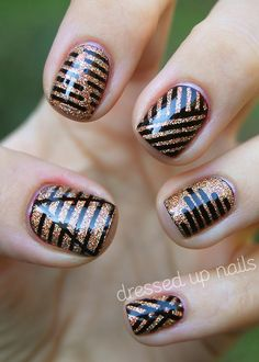 dressedupnails:    I'm pretty pumped about showing y'all my first ADVENTURE IN STRIPING TAPE! I love the clean lines it creates SO MUCH, I can't believe I've never used it before. I wish you guys could see how sparkly these are in real life! You can go check out my blog for more pics and words, including pictures of my ol' right hand!  Also, you can come hang out with me on Facebook!