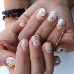 How pretty are these mermaid nails by @sohotrightnail . Featured Shell Japan seashell sticker in crystal white and gold scale decals from @wrapartistnails are available at DAILYCHARME.COM