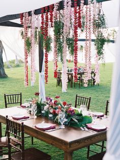 Tropical hanging leis: http://www.stylemepretty.com/destination-weddings/hawaii-weddings/2016/05/19/this-hawaiian-wedding-is-what-destination-wedding-dreams-are-made-of/   Photography: Wendy Laurel - http://www.wendylaurel.com/