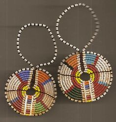 Africa | Pair of Vintage African beaded ear ornaments | Wire, hand cut bone spacers and seed beads.
