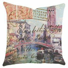 """Handmade in the USA, this artful cotton denim pillow showcases a travel-inspired carte postale motif.   Product: PillowConstruction Material: Cotton denimColor: MultiFeatures:  Made in the USAZipper closure Insert included         Handmade by The Watson ShopDimensions: 16"""" x 16"""" Cleaning and Care: Dry clean only"""