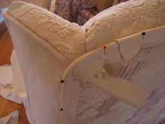DIY:  Wingback Slipcover Tutorial - made from a twin bedspread!  Tons of pics shows every step.
