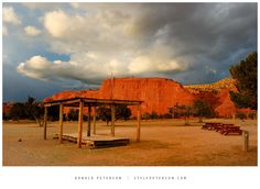 5. The Red Rocks of Jemez: Ah memories. I bought some fry bread under this shelter and then had a conversation with a few folks at these picnic tables. Somehow my brother heard his raffle ticket number over loud activities and a scratchy PA system and was rewarded a beautiful piece of local pottery for his supernatural hearing. It was a blue and red day just like in this photograph.