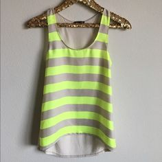Express Striped Tank Like new condition, only worn once! Bright yellow and beige stripes on front with a longer hem in the back. Front of top is 100% Poly and the back is 100% Rayon. No trades, offers welcome! Express Tops Tank Tops