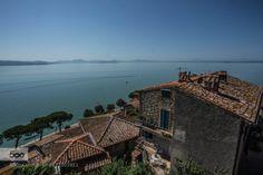 Lake Trasimeno by RobertWilson  Lake Trasimeno Passignano architecture beautiful blue europe green holiday italy sea sky summer tour