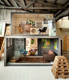timber packing crates stacked to create 'rooms' in which to display artist David Bromley's collection that's on auction www.apicturebook.... #art