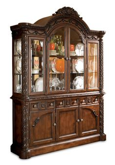 Show off your china in grand traditional style with the North Shore Complete China Cabinet from the North Shore Dining Collection by Ashley Furniture.