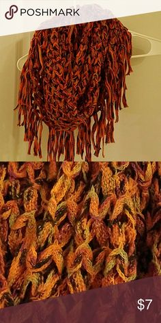 Warm knit orange multicolored infinity scarf This is a super cute and warm infinity scarf! It is predominantly orange with some pink/purple, brown and black hues. In excellent condition! Scarf is shown wrapped twice in picture. Accessories Scarves & Wraps