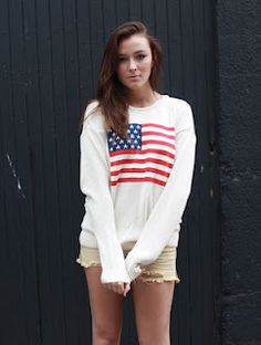 I tried this US flag sweater on at Brandy Melville. It did NOT look as good on me as it does on her. Jellies.