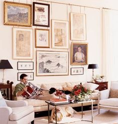 """Fill a blank wall with a collection of paintings, sketches, or prints grouped tightly for an instant focal point. Often called a """"salon wall,"""" its a decorative way to highlight art.     There are no hard-and-fast rules; in fact, a salon wall is meant to look random. The frames shouldn't match, and the arrangement should be asymmetrical, giving each piece equal weight in the room."""