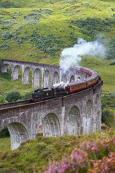 Train on Glenfinnan Viaduct, Scotland The classic train on the Glenfinnan Viaduct in Scotland. This train is also used in the Harry Potter films.