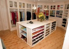 Organized Ladies Closet - traditional - closet - new york - Bianca B... fill an island with slots for shoes!