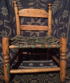 "This is an old child's size caned chair. It must have been painted green at one time. The caned seat is still green but there are only remnants of the green paint on the wood. This is kind of what I call an ""orphan"" chair. 