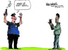 "This picture is ironic because the cop has his hands in the air saying ""don't shoot"" even though they are the ones who have the gun in their hand.  The other person in this picture represents media and its a black person holding a camera phone recording the police man threatening him.  This shows that the police over exaggerate most situations and use guns out of proportion. ZL"
