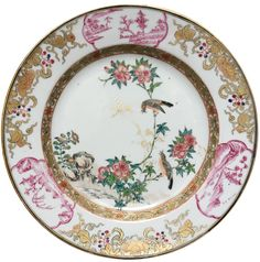 "A Chinese Export Porcelain famille rose plate decorated with two birds. Yongzheng period. Painted in the famille rose palette, with two birds and branches of peonies. On the rim, a gilt decoration of flowers and landscapes painted in ""camaieu carmin""."