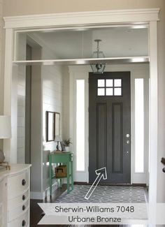 entryway with dark gray door. #interiordoors #InteriorDesignCoursesOnline